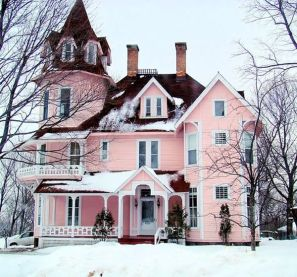 pink house in snow